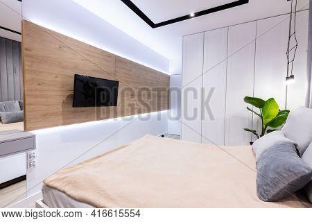 Modern bedroom with comfortable bed in studio apartment. Interior design