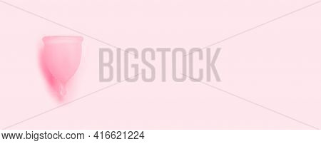 Reusable Silicone Menstrual Cup On A Pink Background. Womens Health And Alternative Hygiene.