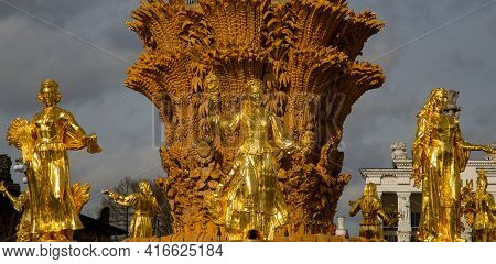 Statues On The Fountain Of Vdnh -women Gilded