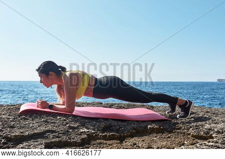 Fitness Latin Woman In Sports Set Training With Elastic Band, Weights, Gym Exercises, In Front Of Th