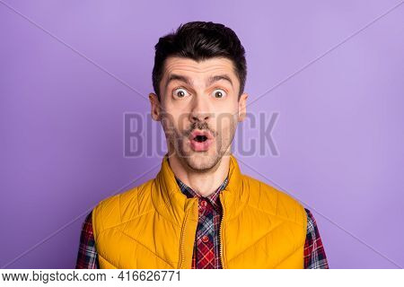 Photo Of Handsome Shocked Guy Dressed Yellow Vest Big Eyes Open Mouth Isolated Purple Color Backgrou