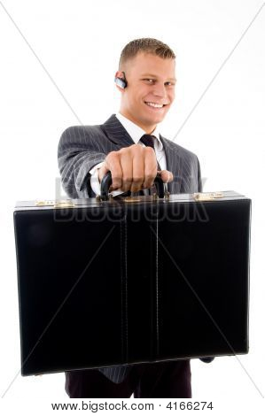 Young Corporate Showing His Briefcase