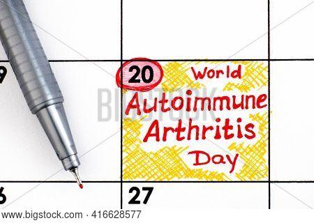 Reminder World Autoimmune Arthritis Day In Calendar With Pen. May 20