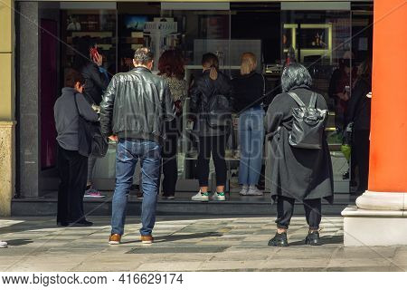 Thessaloniki, Greece - April 12 2021: Click And Collect Open Store Entrance With Waiting Customers.