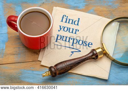 Find your purpose advice or reminder - handwriting on a napkin with a cup of coffee and loupe, life, career and personal development concept