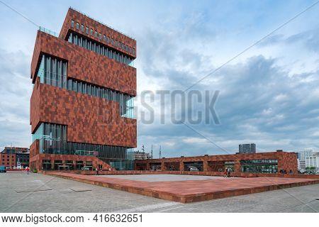Antwerp, Belgium - 04.29.2018: Modern Building Of Muzeum Aan De Stroom, Mas Museum, On A Cold, Cloud
