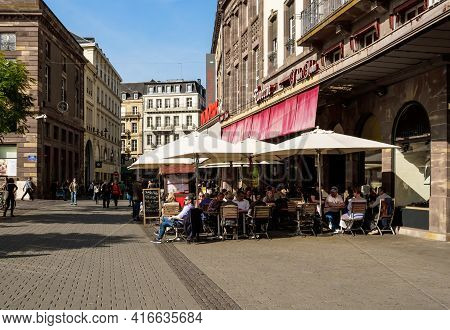 Strasbourg, France - Sep 22, 2017: Side View Of People Enjoying Luch, Cold Beer At The Iconic Brasse