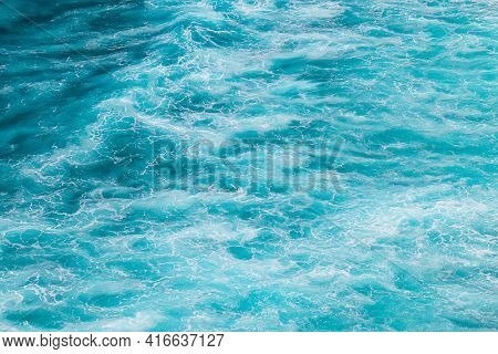 Abstract Sea Background. The Surface Of The Blue, Turquoise Ocean.