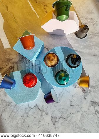Set Of Coffee Capsules Isolated On Marble Background.flat Lay Disposable Coffee Pods . Morning Dose