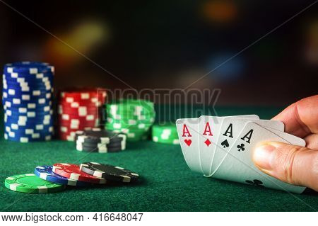 Poker Cards With Four Of A Kind Or Quads Combination. Close Up Of Gambler Hand Takes Playing Cards I