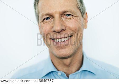 Senior Elegant Caucasian Entrepreneur In Shirt Is Looking At Camera