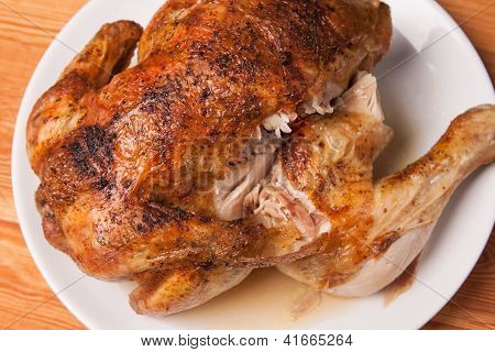 Roast Chicken On White Plate And Wooden