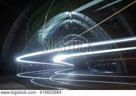 Illuminated Tramway Tunnel With Tram Light Trails At Night In Bratislava, Slovakia