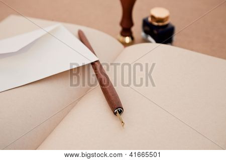 Pen, Letter And Old Book