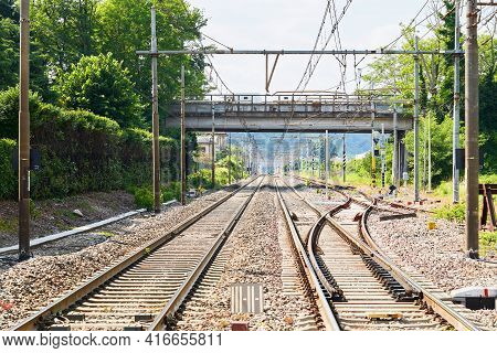 Railway Station In Green Natural Landscape. Industrial Scene With Railroad. Railway Junction, Platfo