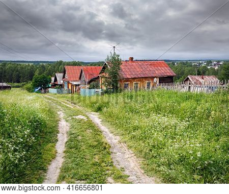 Village Street In Summer. View Of The Traditional Wooden Country Houses. Village Of Visim, Sverdlovs