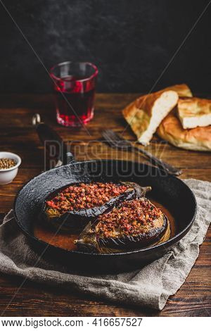 Eggplants Stuffed With Ground Beef, Tomatoes And Spices In Frying Pan. Traditional Dish Karniyarik O