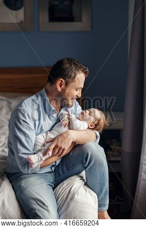 Fathers Day Holiday. Middle Age Caucasian Father With Sleeping Newborn Baby Girl. Parent Holding Roc