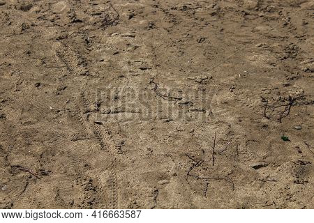 Brown Sand Background. Wet Sand Texture. Grunge Sand Background.