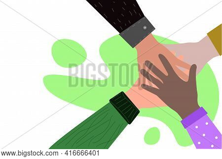 Hands Of Different Skin Tones Are Folded Together. Friendship Of Different Peoples Of The World. Mul
