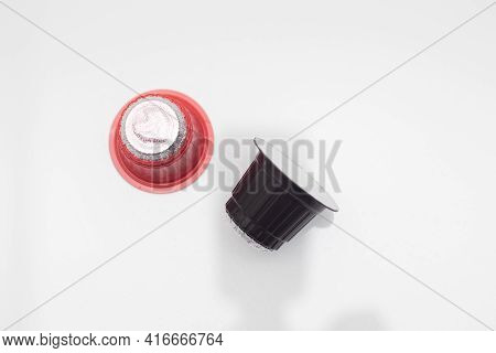 Espresso Coffee Capsules Or Coffee Pods On White Table