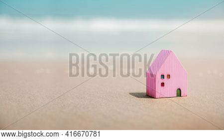 Beach House Concept. Mini Colorful Wooden House On The Sand Beach. Destination For Vacation Or Retir