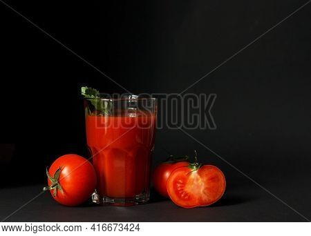 Glass Of Fresh Tomato Juice And Tomatoes