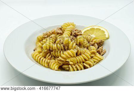 Italian Fusilli Pasta With Tuna And Lemon In A White Dish