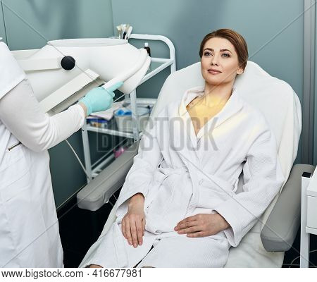 Light Therapy Procedure, Phototherapy. Beautiful Woman Gets A Light Therapy Procedure At A Medical C