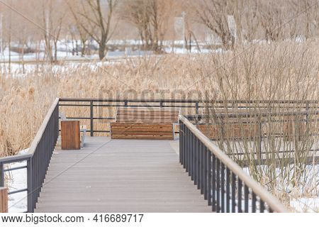 Smooth Wooden Descent To The River In Kapotna. Multi-level Smooth Descent. Wooden Benches On A Woode
