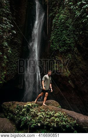 A Man At The Waterfall. A Person Travels Around The World. The Man At The Waterfall. Travel To Bali,