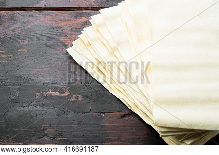 Dried Uncooked Lasagna Pasta Sheets Set, On Old Dark  Wooden Table Background, With Copy Space For T