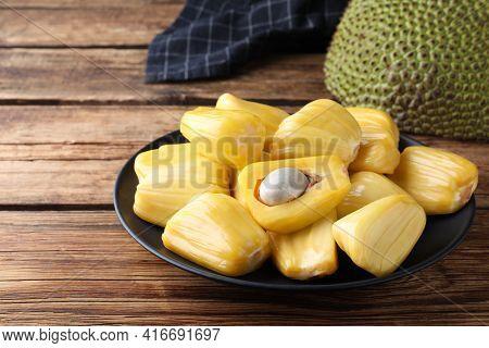 Fresh Exotic Jackfruit Bulbs On Wooden Table