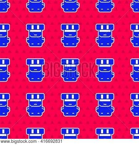 Blue Hiking Backpack Icon Isolated Seamless Pattern On Red Background. Camping And Mountain Explorin