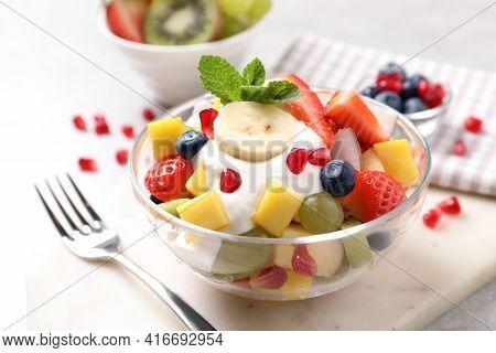 Delicious Fruit Salad With Yogurt On Light Table
