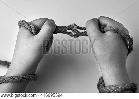 Tearing Rope In The Hands Of A Woman, Liberation Concept, Black And White Photo.