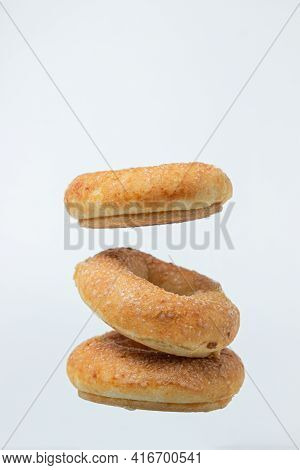 Sweet Donuts On A White Background. Isolated Sweetness On A Light Background. Sweet Bagels