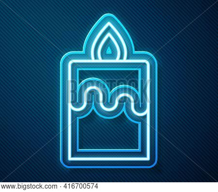 Glowing Neon Line Burning Candle Icon Isolated On Blue Background. Cylindrical Aromatic Candle Stick