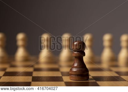 One Unique Pawn Outstanding From Many Opposits. Concept Of Individual, Different, Standout, Original