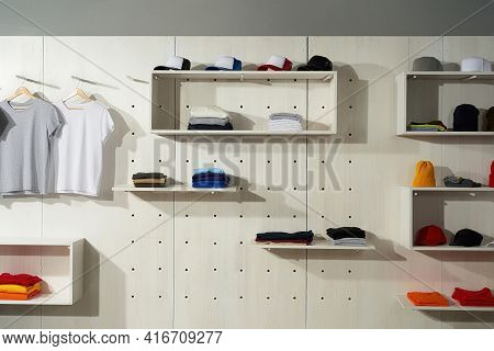 Collection Of Colorful Cotton Clothes Laid Out On The Shelves In The Store. Custom Wear At Clothing