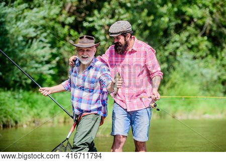 Funny Fishing. Male Friendship. Family Bonding. Two Happy Fisherman With Fishing Rod And Net. Father
