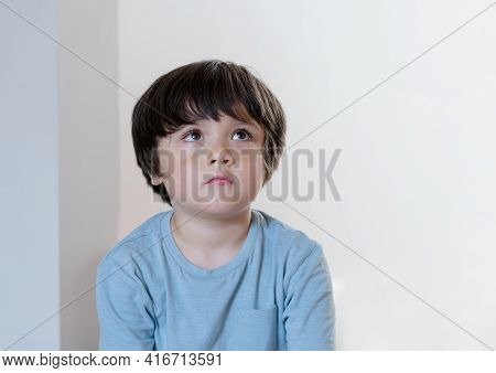 Dramatic Portrait Kid Siting Alone And Lookig Up Deep In Throught, Child Siting On Floor With Curiou