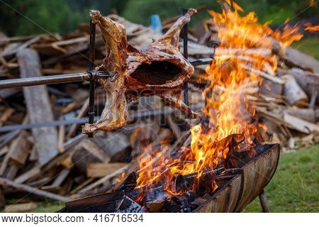 Traditional Cooking Mutton On Fire At The Festival
