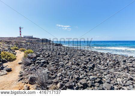Volcanic Ocean Shore Near Lighthouse On Tenerife