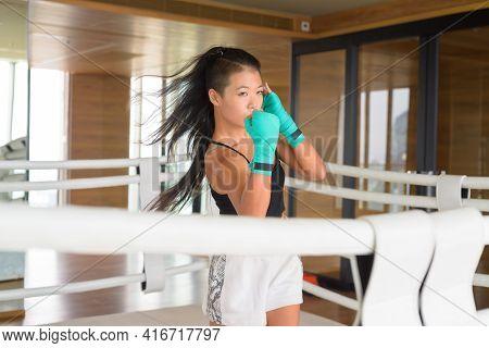 Asian Woman Kick Boxer Shadow Boxing At Gym Boxing Ring