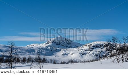 Mount Bitihorn In Norway On A Sunny Winters Day.