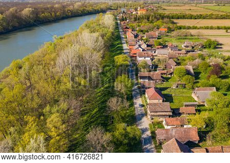Sava River And Old Traditional Village Of Krapje With Typical Wooden Houses, Lonjsko Polje, Croatia,