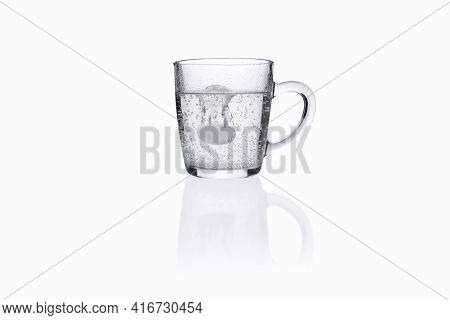 Soluble Effervescent Tablet In Transparent Glass Mug On White Background