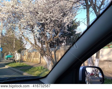 Road View Through Car Window And Mirror, Cars On Road In Traffic In Bucharest, Romania, 2021