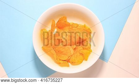 Potato Chips In A Plate, The Number Of Which Gradually Decreases. Top View.